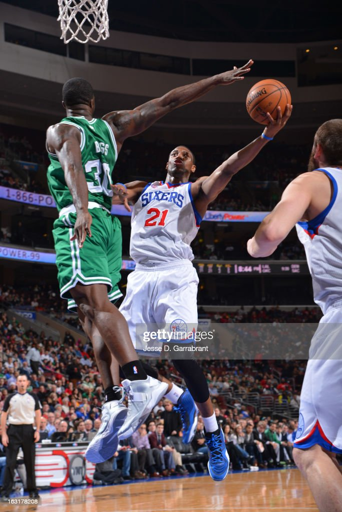 Thaddeus Young #21 of the Philadelphia 76ers goes to the basket against Brandon Bass #30 of the Boston Celtics on March 5, 2013 at the Wells Fargo Center in Philadelphia, Pennsylvania.