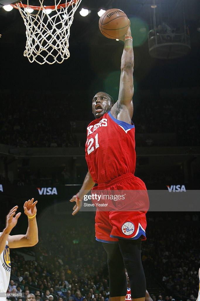<a gi-track='captionPersonalityLinkClicked' href=/galleries/search?phrase=Thaddeus+Young&family=editorial&specificpeople=3847270 ng-click='$event.stopPropagation()'>Thaddeus Young</a> #21 of the Philadelphia 76ers goes up for the dunk against the Golden State Warriors on December 28, 2012 at Oracle Arena in Oakland, California.