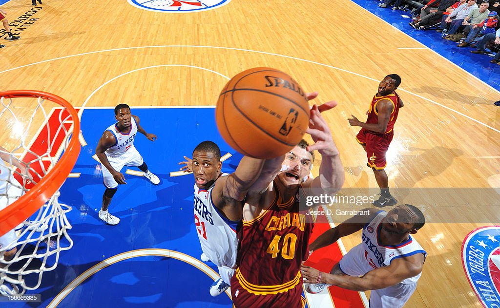 Thaddeus Young #21 of the Philadelphia 76ers grabs the ball against Tyler Zeller #40 of the Cleveland Cavaliers at the Wells Fargo Center on November 18, 2012 in Philadelphia, Pennsylvania.