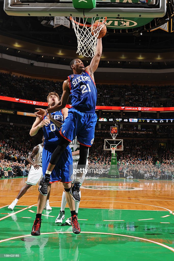 Thaddeus Young #21 of the Philadelphia 76ers pulls down a rebound against the Boston Celtics on December 8, 2012 at the TD Garden in Boston, Massachusetts.