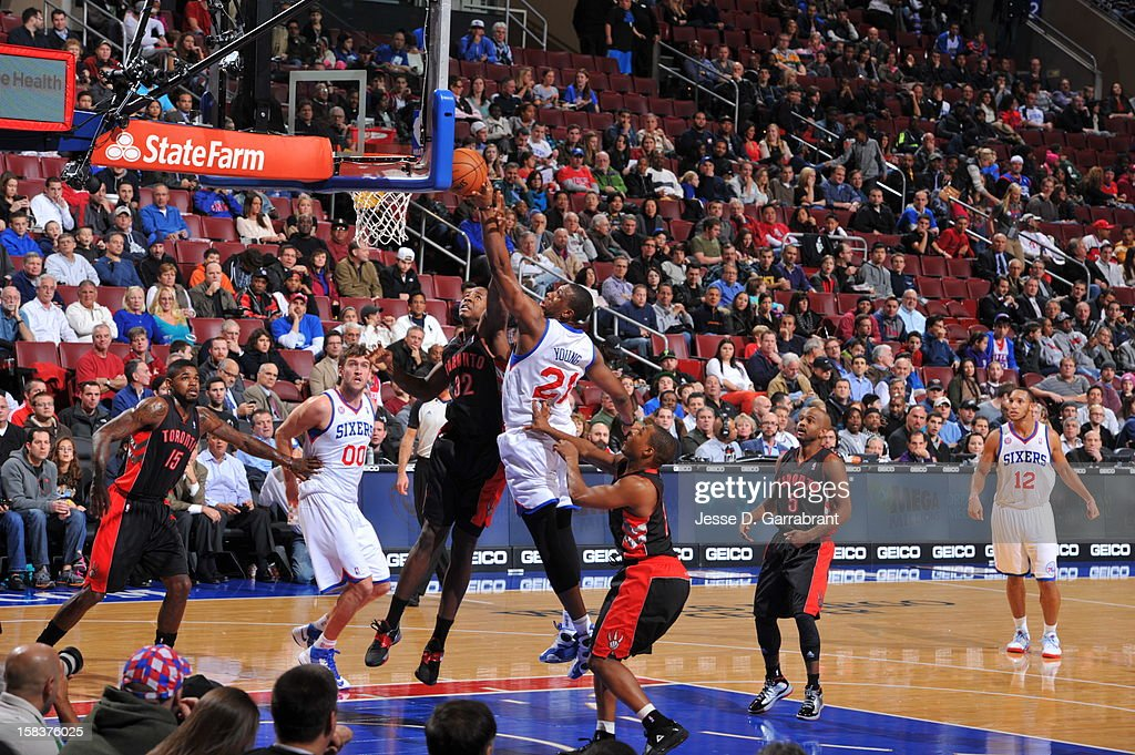 <a gi-track='captionPersonalityLinkClicked' href=/galleries/search?phrase=Thaddeus+Young&family=editorial&specificpeople=3847270 ng-click='$event.stopPropagation()'>Thaddeus Young</a> #21 of the Philadelphia 76ers puts up a shot over Ed Davis #32 of the Toronto Raptors at the Wells Fargo Center on November 20, 2012 in Philadelphia, Pennsylvania.