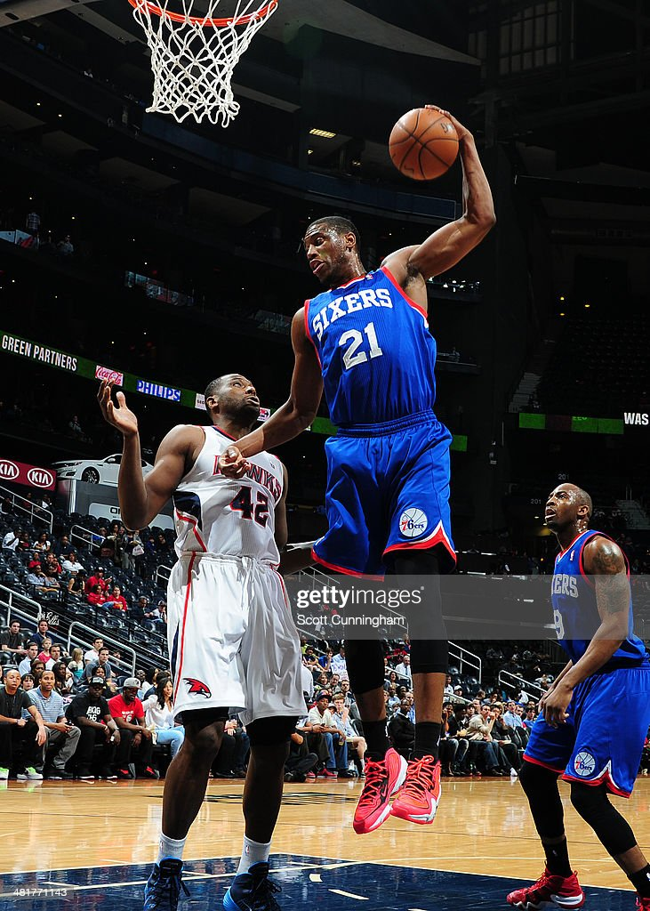 <a gi-track='captionPersonalityLinkClicked' href=/galleries/search?phrase=Thaddeus+Young&family=editorial&specificpeople=3847270 ng-click='$event.stopPropagation()'>Thaddeus Young</a> #21 of the Philadelphia 76ers rebounds against the Atlanta Hawks on March 31, 2014 at Philips Arena in Atlanta, Georgia.