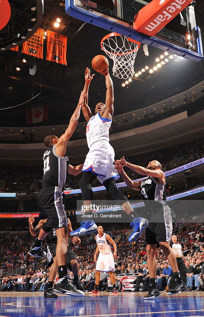 <a gi-track='captionPersonalityLinkClicked' href=/galleries/search?phrase=Thaddeus+Young&family=editorial&specificpeople=3847270 ng-click='$event.stopPropagation()'>Thaddeus Young</a> #21 of the Philadelphia 76ers rises for a dunk against <a gi-track='captionPersonalityLinkClicked' href=/galleries/search?phrase=Tim+Duncan&family=editorial&specificpeople=201467 ng-click='$event.stopPropagation()'>Tim Duncan</a> #21 and Tony Parker #9 of the San Antonio Spurs during the game at the Wells Fargo Center on January 21, 2013 in Philadelphia, Pennsylvania.