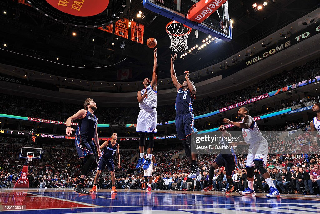 Thaddeus Young #21 of the Philadelphia 76ers shoots a layup against Bismack Biyombo #0 of the Charlotte Bobcats at the Wells Fargo Center on March 30, 2013 in Philadelphia, Pennsylvania.