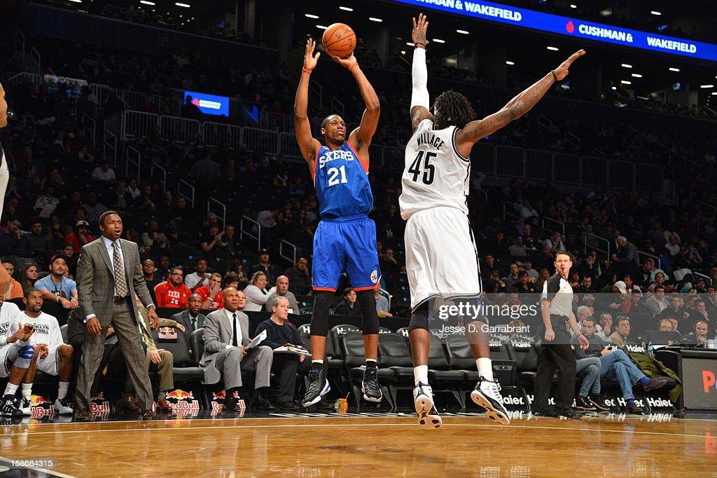Thaddeus Young #21 of the Philadelphia 76ers shoots a shot against Gerald Wallace #45 of the Brooklyn Nets during the game at the Barclays Center on December 23, 2012 in Brooklyn, New York.
