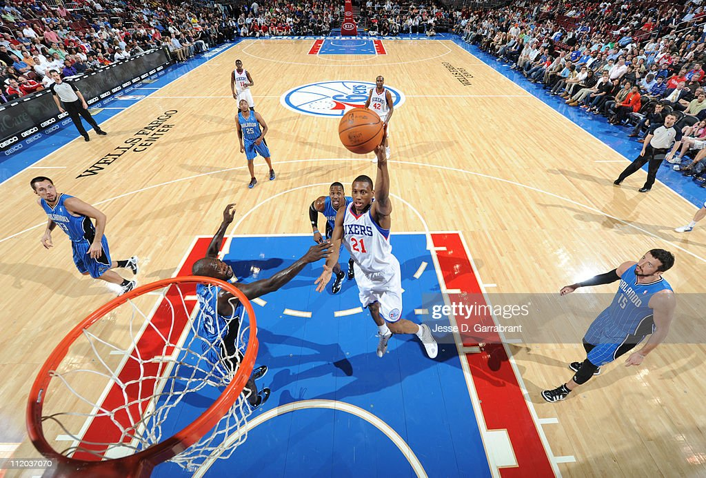 <a gi-track='captionPersonalityLinkClicked' href=/galleries/search?phrase=Thaddeus+Young&family=editorial&specificpeople=3847270 ng-click='$event.stopPropagation()'>Thaddeus Young</a> #21 of the Philadelphia 76ers shoots against <a gi-track='captionPersonalityLinkClicked' href=/galleries/search?phrase=Jason+Richardson+-+Basketball+Player+-+Born+1981&family=editorial&specificpeople=201558 ng-click='$event.stopPropagation()'>Jason Richardson</a> #23 of the Orlando Magic on April 11, 2011 at the Wells Fargo Center in Philadelphia, Pennsylvania.