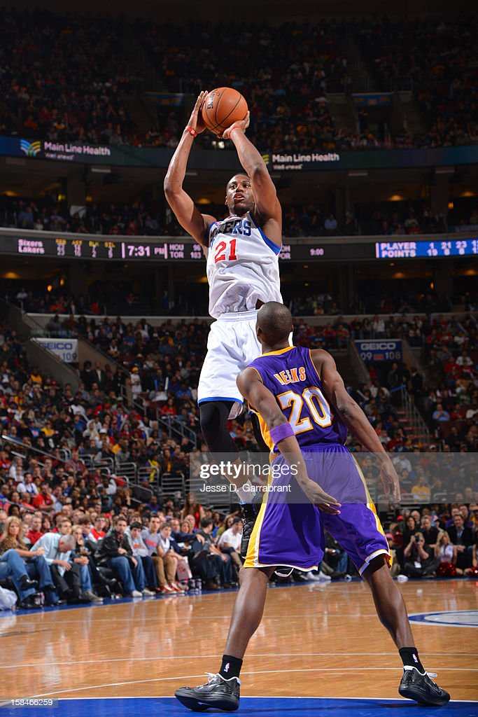 Thaddeus Young #21 of the Philadelphia 76ers shoots against Jodie Meeks #20 of the Los Angeles Lakers on December 16, 2012 at the Wells Fargo Center in Philadelphia, Pennsylvania.