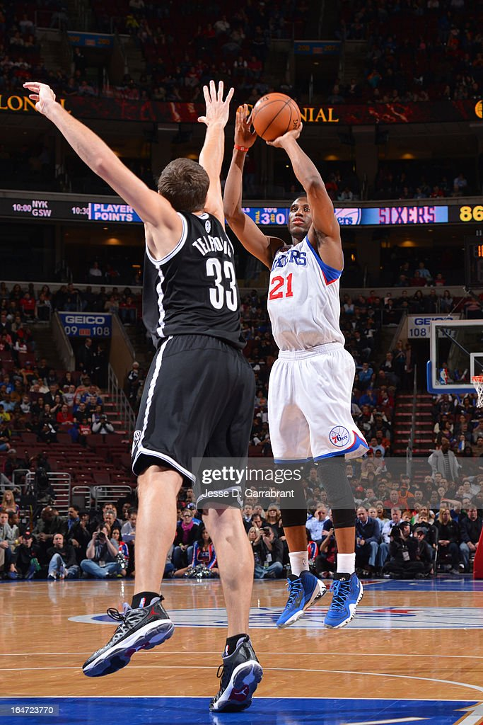 Thaddeus Young #21 of the Philadelphia 76ers shoots against Mirza Teletovic #33 of the Brooklyn Nets at the Wells Fargo Center on March 11, 2013 in Philadelphia, Pennsylvania.