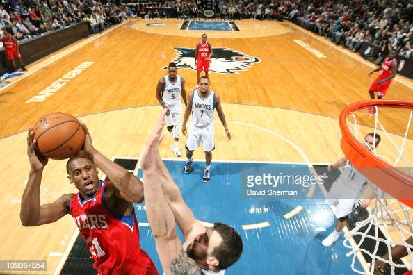 Thaddeus Young of the Philadelphia 76ers shoots against Nikola Pekovic of the Minnesota Timberwolves on February 19 2012 at Target Center in...