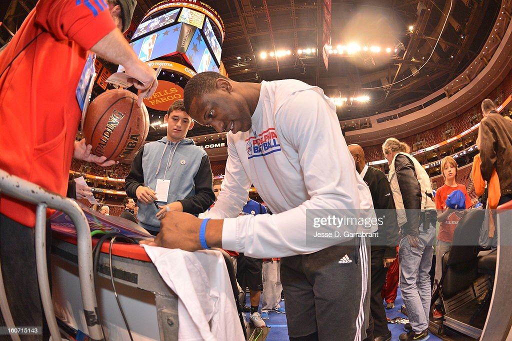 Thaddeus Young #21 of the Philadelphia 76ers signs autographs before the game against the Orlando Magic at the Wells Fargo Center on February 4, 2013 in Philadelphia, Pennsylvania.