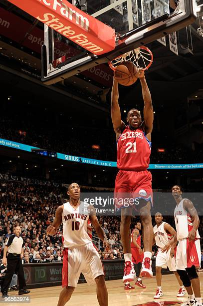 Thaddeus Young of the Philadelphia 76ers slam dunks ahead of DeMar DeRozan of the Toronto Raptors during a game on February 10 2010 at the Air Canada...