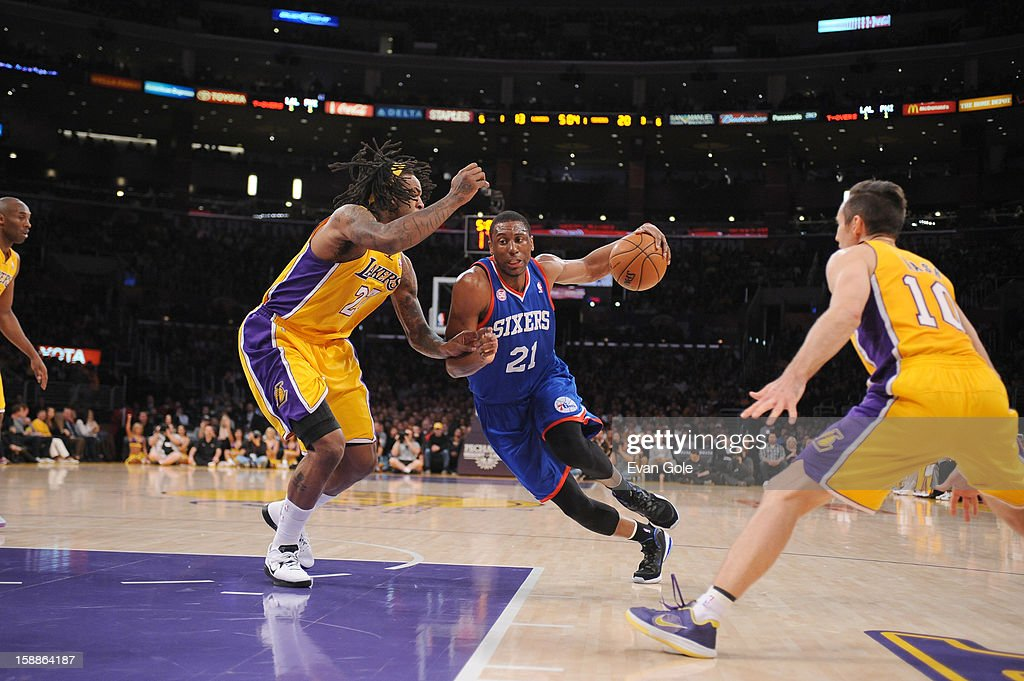Thaddeus Young #21 of the Philadelphia 76ers splits defense defense of Jordan Hill #27 and Steve Nash #10 of the Los Angeles Lakers during the game between the Philadelphia 76ers and the Los Angeles Lakers at Staples Center on January 1, 2013 in Los Angeles, California.