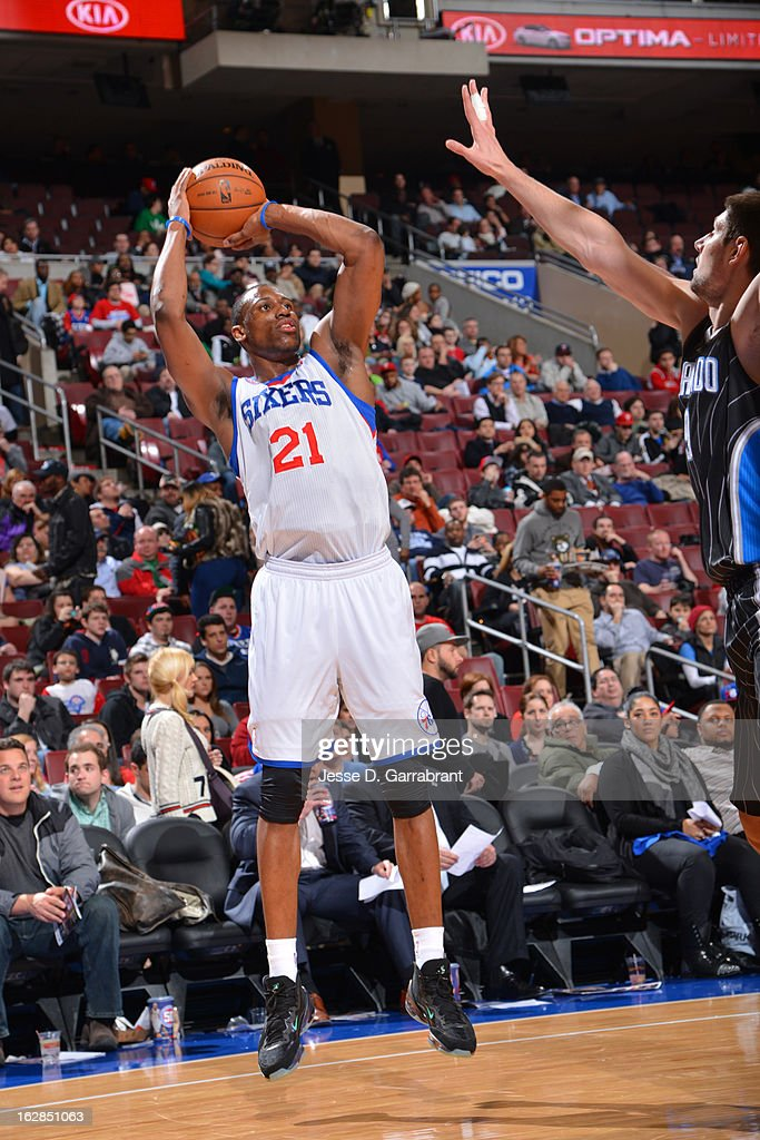 <a gi-track='captionPersonalityLinkClicked' href=/galleries/search?phrase=Thaddeus+Young&family=editorial&specificpeople=3847270 ng-click='$event.stopPropagation()'>Thaddeus Young</a> #21 of the Philadelphia 76ers takes a shot against the Orlando Magic at the Wells Fargo Center on February 26, 2013 in Philadelphia, Pennsylvania.