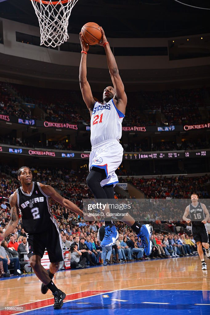 <a gi-track='captionPersonalityLinkClicked' href=/galleries/search?phrase=Thaddeus+Young&family=editorial&specificpeople=3847270 ng-click='$event.stopPropagation()'>Thaddeus Young</a> #21of the Philadelphia 76ers rises for a dunk against <a gi-track='captionPersonalityLinkClicked' href=/galleries/search?phrase=Kawhi+Leonard&family=editorial&specificpeople=6691012 ng-click='$event.stopPropagation()'>Kawhi Leonard</a> #2 of the San Antonio Spurs during the game at the Wells Fargo Center on January 21, 2013 in Philadelphia, Pennsylvania.