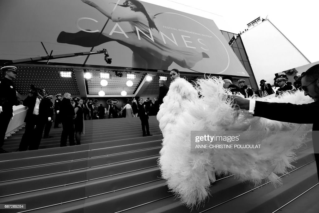 Thai actress Araya Alberta Hargate known as Chompoo poses as she arrives on May 17, 2017 for the screening of the film 'Ismael's Ghosts' (Les Fantomes d'Ismael) during the opening ceremony of the 70th edition of the Cannes Film Festival in Cannes, southern France. / AFP PHOTO / Anne-Christine POUJOULAT