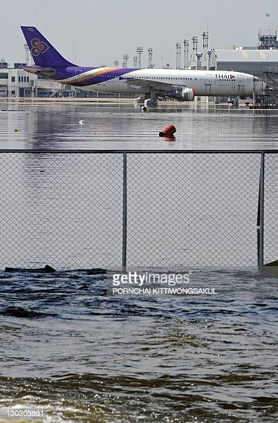 A Thai airways aircraft is surrounded by floodwater at Don Mueang airport in Bangkok on October 26 2011 Thailand's premier warned a confused and...