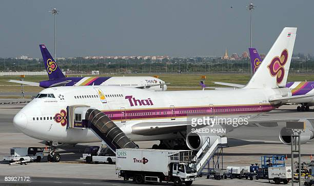 Thai airways planes are parked at the tarmac of the Suvarnabhumi Airport in Bangkok on December 4 2008 Thai Airways is planning to sue antigovernment...