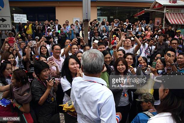 Thai antigovernment protest leader Suthep Thaugsuban greets his supporters during a march in downtown Bangkok as part of their ongoing rallies The...