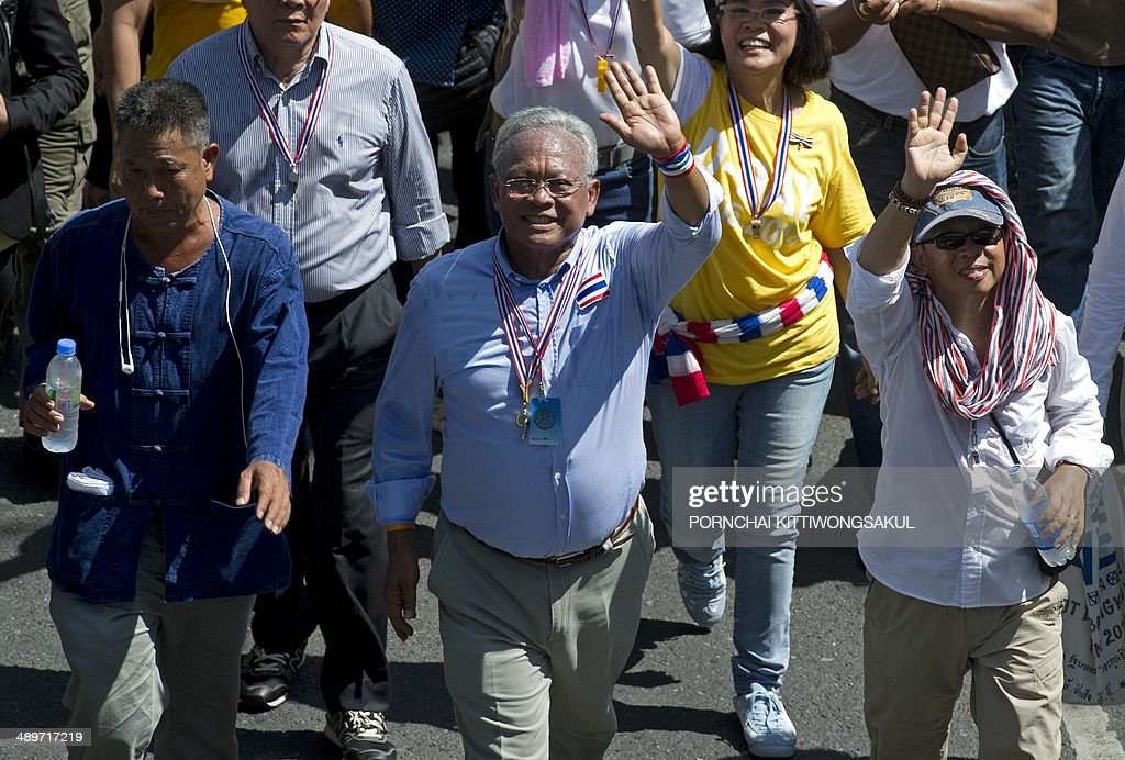 Thai anti-government protest leader <a gi-track='captionPersonalityLinkClicked' href=/galleries/search?phrase=Suthep+Thaugsuban&family=editorial&specificpeople=5734971 ng-click='$event.stopPropagation()'>Suthep Thaugsuban</a> (C) waves during a rally in Bangkok on May 12, 2014. Thailand's authorities warned on May 11 that opposition efforts to hand power to an unelected regime risked unleashing new violence, as rival protesters prepared for a showdown over the fate of the crippled government.
