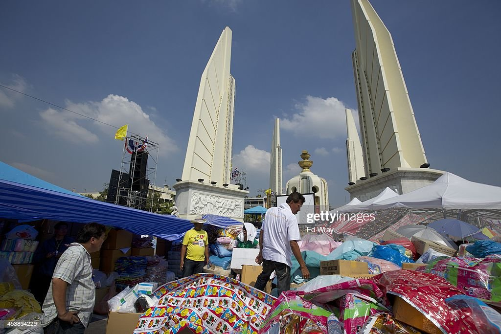 Thai antigovernment protesters sort through piles of supplies at their protest headquarters at the Democracy Monument on December 6 2013 in Bangkok...