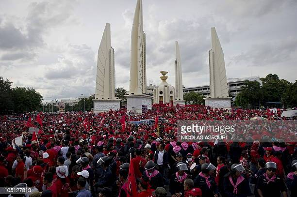 Thai antigovernment 'Red Shirt' protesters gather around the Democracy Monument in Bangkok on October 10 2010 Thousand of antigovernment protesters...