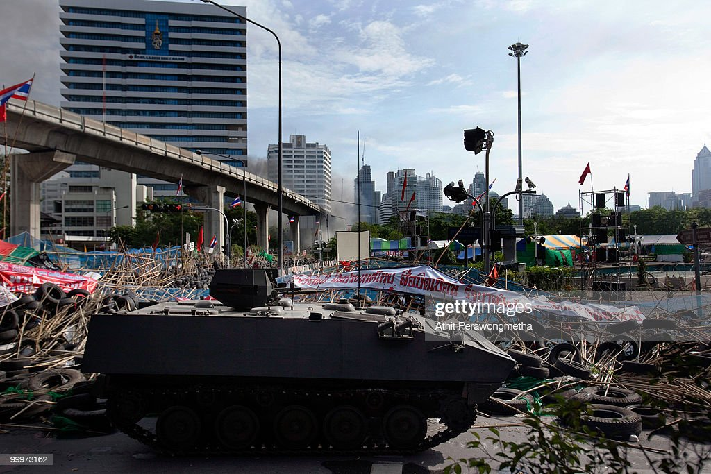 A Thai armoured personnel carrier breaks down a barricade made by Anti-government protesters 'Red Shirt', on May 19, 2010 in Bangkok, Thailand. Protesters have clashed with military forces for six consecutive days in Bangkok after the government launched an operation to disperse anti-government protesters who have closed parts of the city for more than two months. Despite calls from the United Nations for both sides to begin talks, anti-government protesters in Bangkok have defied orders to leave their fortified camp, with 37 people having died and more than 260 injured since the military began its crackdown.