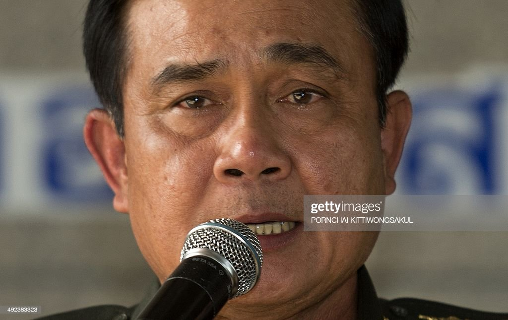 Thai Army chief General Prayut Chan-O-Cha answers a question during a press conference at the Army Club in Bangkok on May 20, 2014. Thailand's army declared martial law after months of deadly anti-government protests, deploying armed troops in central Bangkok and censoring the media but insisting the move was 'not a coup'.