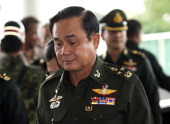 Thai army chief General Prayut ChanOCha arrives for a meeting at the Army Club in Bangkok on May 20 2014 Thailand's army declared martial law after...