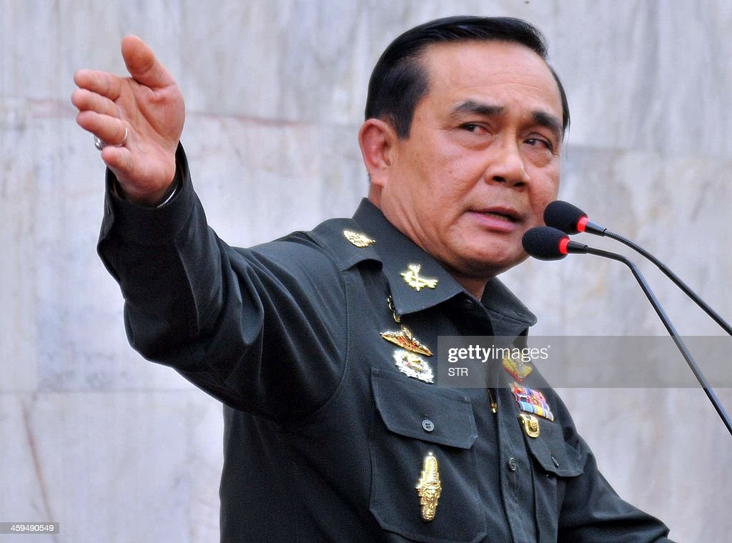 Thai army chief General Prayut Chan-O-Cha gestures as he speaks during a press conference at Thai army's headquarter in Bangkok on December 27, 2013. The Thai government appealed to the military to provide security for February elections after violent clashes between police and opposition protesters left two people dead and more than 150 wounded. AFP PHOTO
