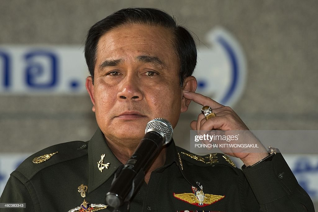 Thai Army chief General Prayut Chan-O-Cha gestures during a press conference at the Army Club in Bangkok on May 20, 2014. Thailand's army declared martial law after months of deadly anti-government protests, deploying armed troops in central Bangkok and censoring the media but insisting the move was 'not a coup'.