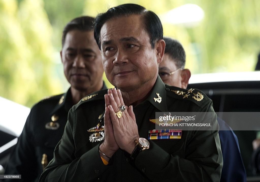 Thai army chief General Prayut Chan-O-Cha gives a traditional greeting to delegates prior to a meeting at the Army Club in Bangkok on May 20, 2014. Thailand's army declared martial law after months of deadly anti-government protests, deploying armed troops in central Bangkok and censoring the media but insisting the move was 'not a coup'.
