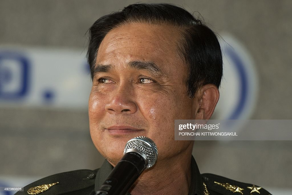 Thai Army chief General Prayut Chan-O-Cha smiles as answers a question during a press conference at the Army Club in Bangkok on May 20, 2014. Thailand's army declared martial law after months of deadly anti-government protests, deploying armed troops in central Bangkok and censoring the media but insisting the move was 'not a coup'.