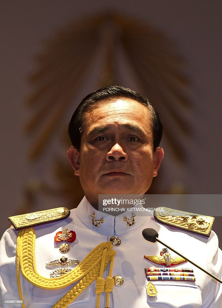 Thai army chief General Prayut ChanOCha speaks during a press conference at the army headquarters in Bangkok on May 26 2014 Thailand's king has...