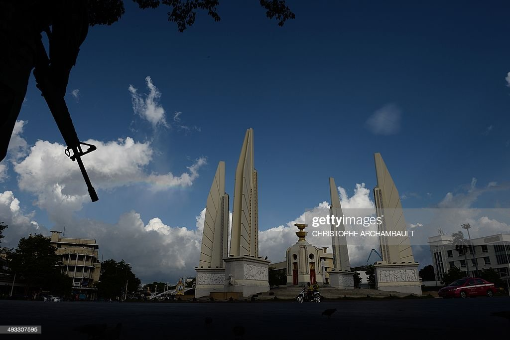 A Thai army soldier stands guard at Democracy Monument as the site of months of antigovernment protests is cleaned up a day after the Thai army...