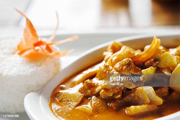 Thai beef red curry, garnished with a carved carrot butterfly
