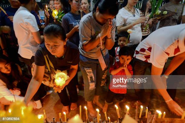 Thai Buddhist a candle to celebrate during a ceremony marking Asalha Puja Day in Wat Asokaram Samut Prakan Thailand 8 July 2017 Asalha Puja brings...