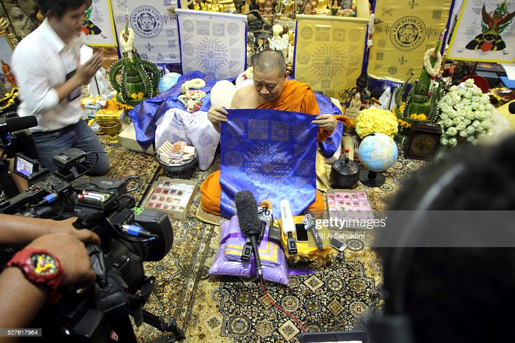 Thai Buddhist monk Phra Prommangkalachan displays a sacred holy unbeatable Leicester City fabric and talisman to members of the media at Wat Traimit temple in Bangkok. The Thai Buddhist monk became famous and well known as a magic monk as he is credited to be a part of Leicester City's success after he traveled several times to King Power Stadium in England.