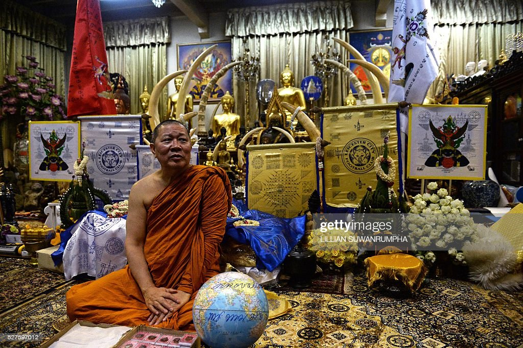 Thai Buddhist monk Phra Prommangkalachan, who had blessed Leicester City football players, looks on during a press conference at the Traimitr Withayaram Woraviharn Temple in Bangkok on May 3, 2016. The Buddhist monk who has blessed Leicester City's players and stadium said he prayed deep into the night as the Foxes pulled off one of the biggest ever sporting shocks by winning the English Premier League. Phra Prommangkalachan, who has travelled to the Midlands club several times with its billionaire Thai owner, said he was praying during second-placed Tottenham Hotspur's 2-2 draw at Chelsea, which gave Leicester the title. / AFP / LILLIAN