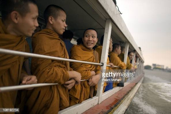 Thai Buddhist monks journey down the Chao Phraya river on a passenger ferry on January 3 2007 in Bangkok Thailand The Chao Phraya is Bangkok's main...