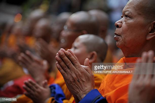 Thai Buddhist monks lead a religious ceremony in memory of antigovernment protesters who died in street clashes between demonstrators and armed...