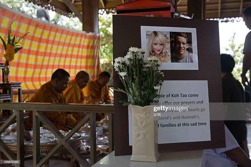 Thai Buddhist monks recite prayers during a religious ceremony held in memory of two murdered British tourists on the southern resort island of Koh...