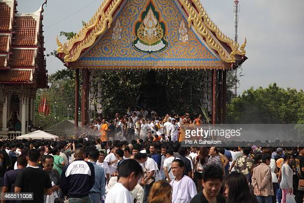 Thai Buddhist monks spraying holy water on the crowd at the annual tattoo festival ceremonies at Wat Bang Phra temple in Nakhon Pathom Several...