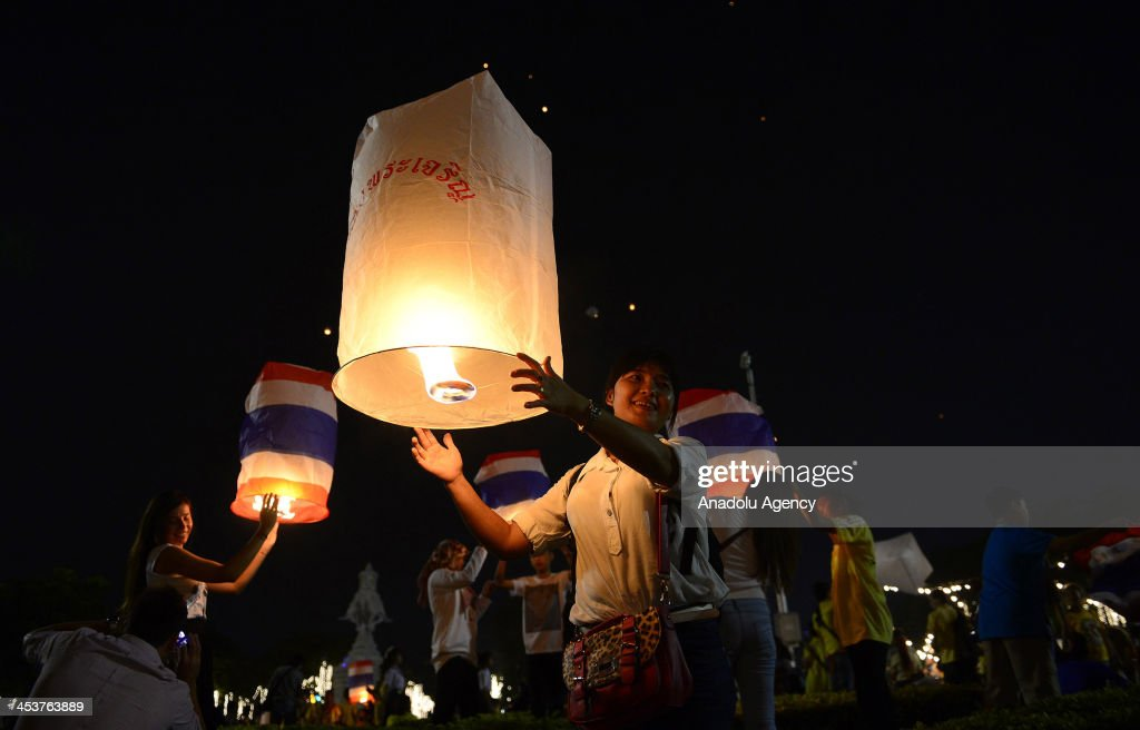 Thai citizens release paper lanterns at Sanam Luang to celebrate the 86th birthday of King Bhumibol Adulyadej on December 5, 2013 in Bangkok, Thailand.