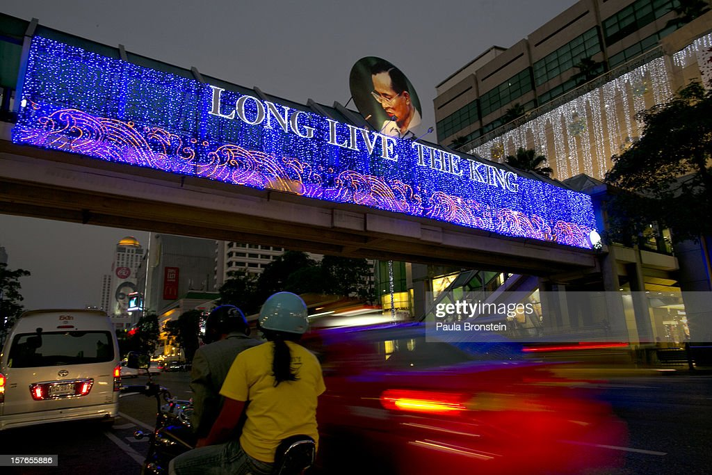 Thai commuters head home past street light decorations during celebrations to pay respect to Thailand's King Bhumibol Adulyadej on his 85th birthday December 5, 2012 in Bangkok, Thailand. King Bhumibol took the throne in 1946, making him the world's longest reigning monarch and the world's longest serving head of state. Yellow represents Monday, the birthday of the King.