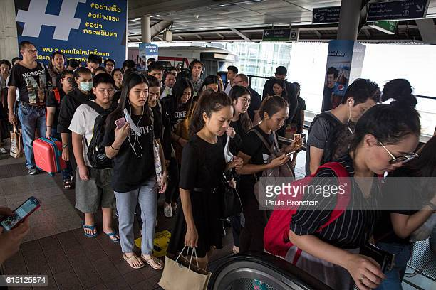 Thai commuters ride the Bangkok Sky Train honoring the late King by wearing black on October 17 2016 in Bangkok Thailand Thailand's King Bhumibol...