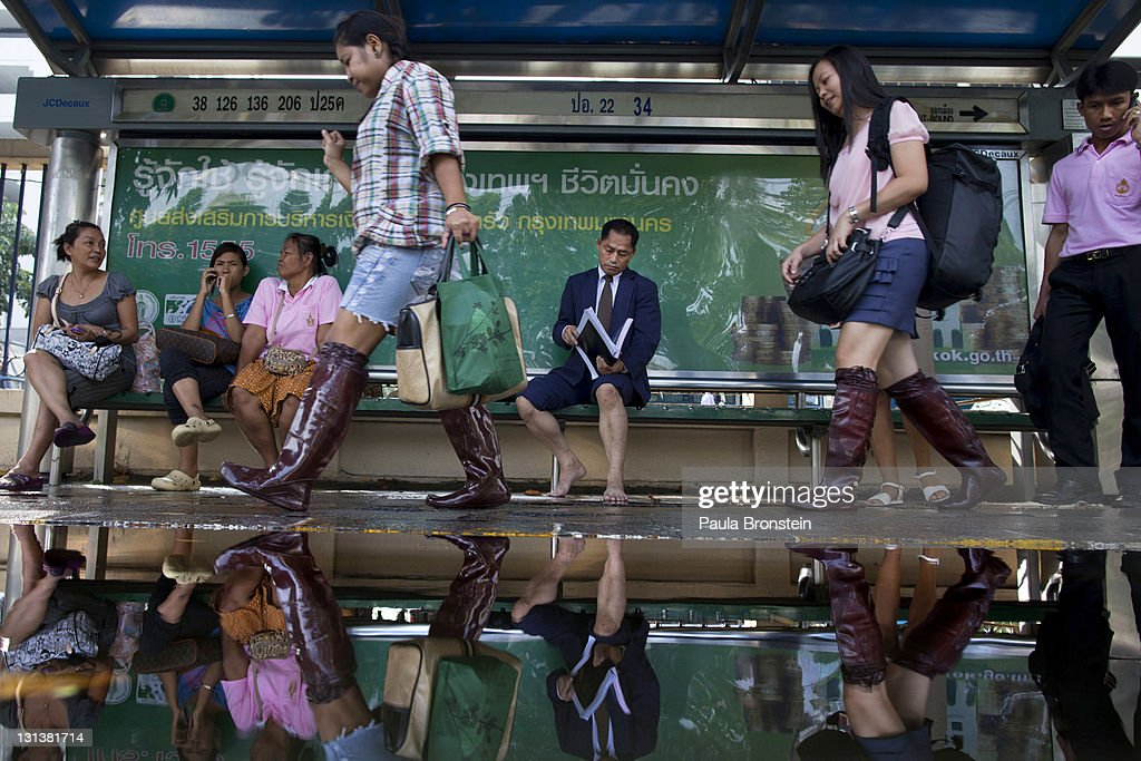 Thai commuters wait for a bus heading home at a major intersection where the floods have moved to in the central Ladprao area of the capitol city November 4, 2011 in Bangkok, Thailand. Over seven major industrial parks in Bangkok and, thousands of factories have been closed in the central Thai province of Ayutthaya and Nonthaburi with millions of tons of rice damaged. Thailand is experiencing the worst flooding in over 50 years which has affected more than nine million people. Over 400 people have died in flood-related incidents since late July according to the Department of Disaster Prevention and Mitigation.
