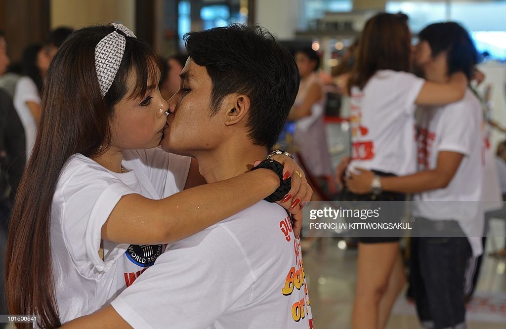 Thai couples kiss during a competition for the 'World's Longest Continous Kiss' ahead of Valentine's Day in Pattaya on February 12, 2013. Nine couples took part in the kissing marathon in the hope of breaking the Guinness world record, and in the process to receive prizes totalling more than 200,000 Thai baht (6,700 USD) and a diamond ring.