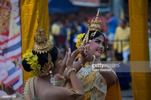 Thai dancers prepare to perform during a parade and ceremony in honor of the King's birthday on December 3 2014 in Chiang Mai Thailand December 5th...