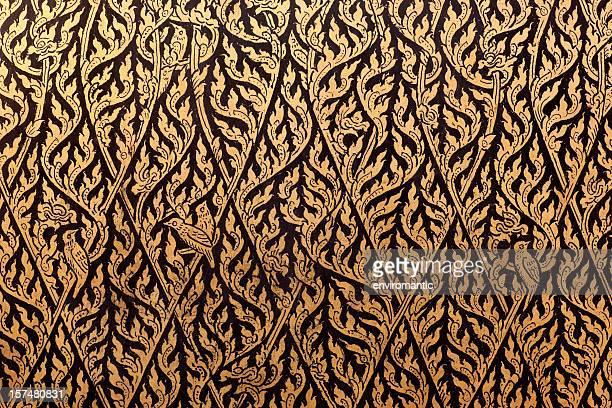 Thai decorative gilt lacquer motif on an antique cabinet.