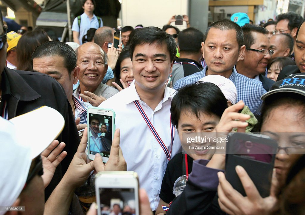 Thai Democrat Party Leader <a gi-track='captionPersonalityLinkClicked' href=/galleries/search?phrase=Abhisit+Vejjajiva&family=editorial&specificpeople=645779 ng-click='$event.stopPropagation()'>Abhisit Vejjajiva</a> poses for photograph for his suppporters on his way to the intersection occupied by the demonstrators on January 13, 2014 in Bankok, Thailand.